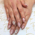 Nude almond shape nails with swarovski details