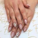 Nude almond shape nails with swarovski details